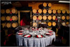 Beautiful red and black cask room wedding reception decor at Chateau Elan Winery & Resort. Learn more about North Georgia's premier wedding and event venue at www.chateauelan.com