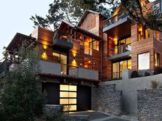 green building, modern house design  NS: The stonework and wood, the cascade, the atmospheric lighting.
