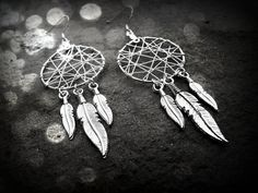 Dream Catcher Earrings - 6 feathered. $15.00, via Etsy.