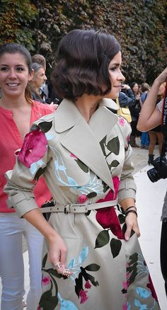 Even on a rainy day, florals will bloom on this trench coat.