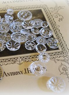 Vintage crystal clear, pressed glass buttons. The clear glass and blk glass and silver metal-toned ones are my personal favs!