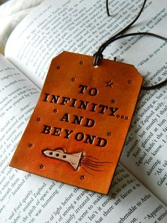 Leather Luggage Tag - Toy Story Quote - Buzz Lightyear - To Infinity and Beyond - Original Space Ship Design. $20.00, via Etsy.