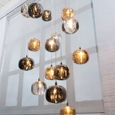 The Cubie Pendant Light is made of crystal that has been formed with rounded edges to create an organic shape.