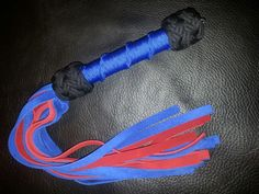 "Red and blue suede pocket flogger. 12""x3/8"" falls."