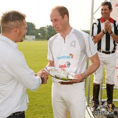LONDON, ENGLAND - MAY 28: Tom Hardy presents Prince William, Duke of Cambridge, with a trophy on behalf of Team Audi Ultra during day one of the Audi Polo Challenge at Coworth Park on May 28, 2016 in London, England.