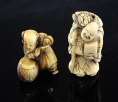 Two Japanese netsuke, 19th century, the first probably in stag horn of a Sennin with a turtle upon his back, 4.5cm., the second in ivory of a boy playing a flute, 3.8cm.