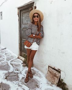 Boater hat, white denim shorts, tan cross body bag. Outfit inspiration.