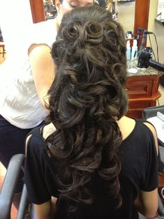 Soft, curly formal hairstyle for long hair.