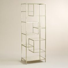 Add visual interest and a dash of glamor to your space with our asymmetrical shelving, crafted of burnished gold-silver metal that plays well with any decor. Glass shelves lend the piece an airy feel, while the mirrored top and bottom beautifully reflect what you put on display. Amply sized, it's perfect for use as a bar back, used to hold escort cards, favors, or double as a unique room divider.