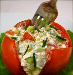 cottage cheese stuffed tomatoes with cucumber, green onion, and pepper.