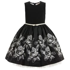 Monnalisa Chic gorgeous black sleeveless dress, in a classic and elegant style, with an ivory, synthetic leather belt featuring a sweet bow. The top is made from soft neoprene, and the silky smooth skirt has beautiful embroidered flowers in white. With many layers of tulle net pettitcoat, the skirt has a fabulous, full and feminine shape and fastens at the back with a concealed zip.<br /> <ul> <li>Top: 94% polyester, 6% elastane (smooth neoprene)</li> <li>Skirt: 73% acetate, 27% polyester…