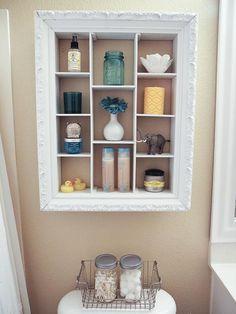 vintage frame as a bathroom storage