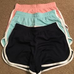 Set of 3 Athletic Shorts Kids Medium Adult XS Navy, light blue, and light pink athletic shorts from Sports Authority. I purchased them in the children's section but wore them as an adult. Should fit an adult XS. No stains or tear, no peeling. Aspire Other