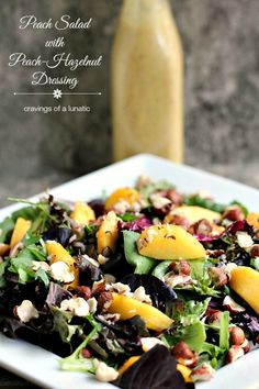 Peach Salad with Peach-Hazelnut Dressing by Cravings of a Lunatic - This salad is made with fresh peaches and greens, then topped with a homemade peach-hazelnut dressing. Toss some hazelnuts over top and it's perfection! Yum!