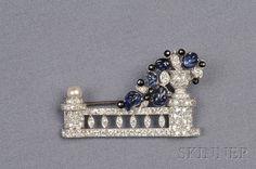 Art Deco Platinum, Carved Sapphire, Onyx, and Diamond Brooch