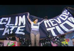Vivienne Westwood, fashion designer, unfurls the CLIMATE REVOLUTION banner at the Paralympics.
