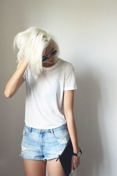 Pair a white crew-neck t-shirt with light blue destroyed denim shorts to effortlessly deal with whatever this day throws at you.   Shop this look on Lookastic: https://lookastic.com/women/looks/white-crew-neck-t-shirt-light-blue-denim-shorts-black-leather-clutch/16470   — White Crew-neck T-shirt  — Light Blue Ripped Denim Shorts  — Black Leather Clutch