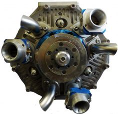 In this new five cylinder engine design from DUKE, the pistons and cylinders rotate as a assembly in a circle behind a fixed plate (shown here with fuel injectors, spark plugs, and exhaust pipes attached). The pistons power a star-shaped reciprocator which provides rotational energy. As the cylinders pass through the circle, fixed ports provide the same function as a complex valve train. Still no word about efficiency.
