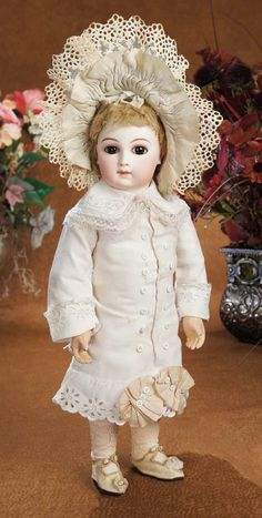 """*FRENCH, BISQUE PREMIERE BEBE ~ By: Jameau Medaille d'Or, Paris (body). early luxury quality premiere bebe w/rare eyes known as """"wraparound"""" beautiful painting including mauve-blushed eye shadow, original wig, original body + body finish, wearing superb white pique bebe dress.....c. 1878"""