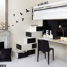very cool storage stairs, although this is very trendy and not so cozy: it doesnt look like somewhere i'd live, or at least not somewhere i'd been living long. I ove lots here though: the slingle shelf desk, the blackbirds. nice.