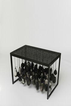 Anna Maria Maiolino Mais 80, da série Preposições, 2014 Raku pieces, shielded copper wire on metal table. Dimensions: 80 (h) x 90 x 55 cm.