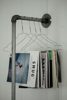 hang 'em Utilize unique nooks and spaces in your apartment by installing poles to hang magazines off.