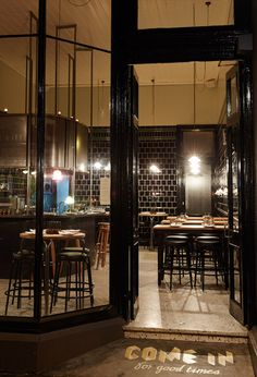 Town Mouse in Melbourne's Drummond Street | Love the black subway tile with light grouting and the pops of wood | Looks like it would be a very welcoming place to stop for late night drink, etc