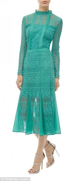 Kate stunned in a £750 green Temperley London gown with her hair in a chic chignon...