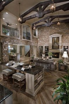 Traditional Great Room with Cement fireplace, Built-in bookshelf, Fireplace, French doors, Balcony, Cathedral ceiling