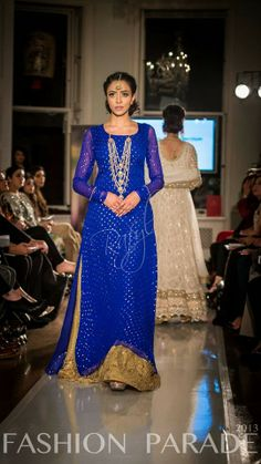 Roshan Pret Exhibition in London. blue and gold Asian outfit
