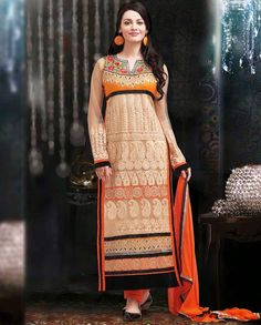 Beige and orange long suit with thread embroidery   1. Beige and orange embroidered georgette long suit2. Comes with matching bottom and dupatta3. Can be stitched upto size 42  inches