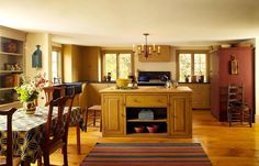 Very nice eat in kitchen.  Soapstone counters.  Butcher block on large island.  Three nice windows.  Wood floor.  Shelves.  Colors.