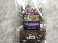 """This classic snack is already portioned into a nice little handful, making it the ideal snack for a sudden surge of hunger. With nuts proving protein and dried cranberries contributing to its sweetness, this mix is a winner.  What Tasters Said: """"Yes! Perfect. I don't like overly salted mix so this is yummy.""""  """"My perfect desk snack.""""  Nutrition Facts: 210 calories, 13g fat, 1.5g sat fat, 20mg sodium, 3g fiber, 8g sugar, 7g protein"""