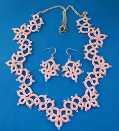 http://darringtondesigns2td.storenvy.com/products/9434359-pink-lace-necklace-and-earrings