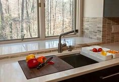 Create a sophisticated look & efficient design by adding a movable cutting board over the kitchen sink!