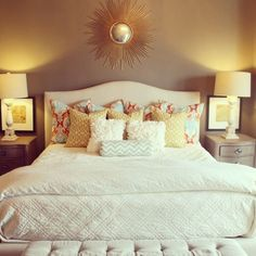 master bedroom, pillow arrangement, picture behind lamp, bench at foot of bed