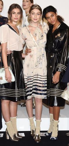 Breton stripes, leather skirts, silk bias cut dresses and black waterproofs worn by Gigi Hadid and Imaan Hammam stole the Tommy Hilfiger show during AW16 New York Fashion Week
