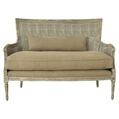 Channeling vintage design influences, this stunning rattan sofa features an upholstered seat and carved wood detailing. Team with neutral decor, bare wood fl...