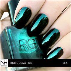 RGB Cosmetics Sea. Metallic Jelly Nail Polish: Black base with Emerald Shimmer (@nailinghwood)