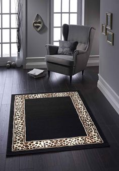 Very Unique Border with a Leopard print in it. It's a great rug to have for any décor. #largerugs #modernrugs #designerrugs #borderedrugs #animalprintrugs #polypropylenerugs #durablerugs