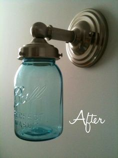 DIY mason jar light Ormand ----too flippin cute! Not sure this will fit in your fixture? Many light fixtures use screws to tighten the fit of the shade, so even if a mason jar isn't the perfect fit the screws can make it a little bit snugger. Pot Mason, Mason Jar Sconce, Mason Jar Lighting, Mason Jar Crafts, Mason Jar Lamp, Do It Yourself Upcycling, Do It Yourself Home, Mason Jar Light Fixture, Light Fixtures