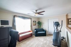 Check out your game room with crown molding and a large window for natural light.