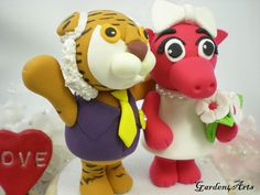 [ GIRRRRL HEAVEN FORBID...]    NEW--LSU Tiger & Arkansas Razorback Wedding Cake Topper - College Mascot Love Couple with Beautiful Stand. $89.00, via Etsy.
