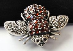 Vintage Sweetest Sterling Silver Garnet Marcasite Bee Insect Brooch or Pendant.  via Etsy.
