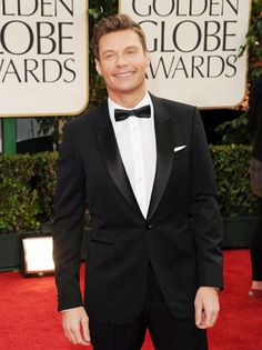 Ryan Seacrest is a classic look with thin bow-tie and pocket square.