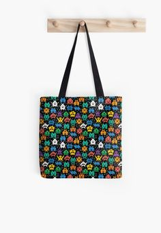 Pixelated Emoji Monster Pattern Illustration by Gordon White | Emoji Monster Tote Bag Hanging from Wall Available @redbubble --------------------------- #redbubble #emoji #emoticon #smiley #faces #cute #addorable #pattern #totebag #bags