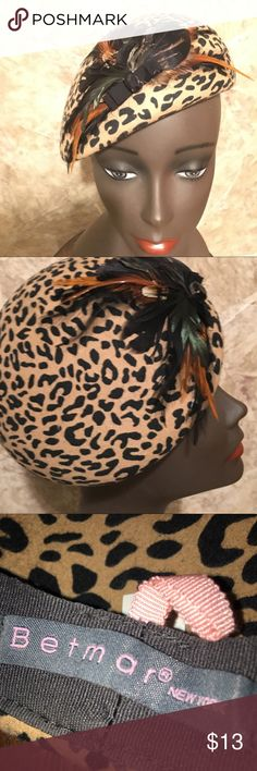 Animal print beret with feathers accent Animal print beret with feather accent. Neutral taupe tone in color. Small to Med size head fit. Like new -worn once. It's such a fun accessory!! Betmar New York Accessories Hats