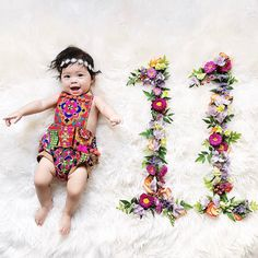Month 11- Boho baby, daisy headband and 70s romper Baby Milestone Flower Flatlay Tutorial DIY for all 12 Months with matching outfit ideas on @Joyfullygreen #babystyle #flowers #flatlay #babymilestone #diy #Monthlynumbers #baby #milestone #monthly #photos #flower #number #flowernumber #diy #tutorial #12months #babygirl #babyoutfits #newborn #pregnancy #maternity #photographer #howto