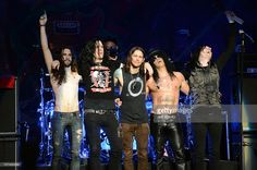 Frank Sidoris, Todd Kerns, Myles Kennedy, Slash and Brent Fitz of Slash featuring Myles Kennedy and the Conspirators performs at the Wiltern Theater on December 2, 2012 in Los Angeles, California.