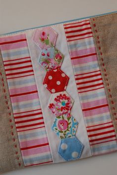 Hex accented pouch with great zipper tutorial.
